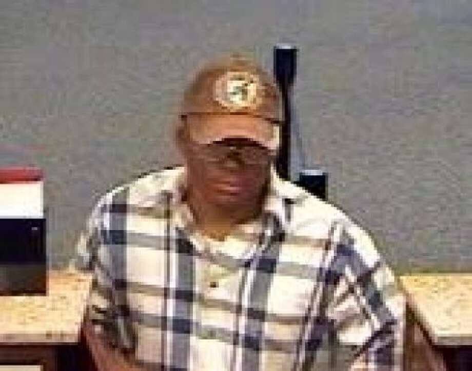 Federal law enforcement agents said this man walked into the Amegy of Texas branch in the 2100 block of Taylor on Friday afternoon and handed the teller a note that demanded cash. He fled in a maroon and cream Ford F-250 or F-350 pickup. Photo: FBI