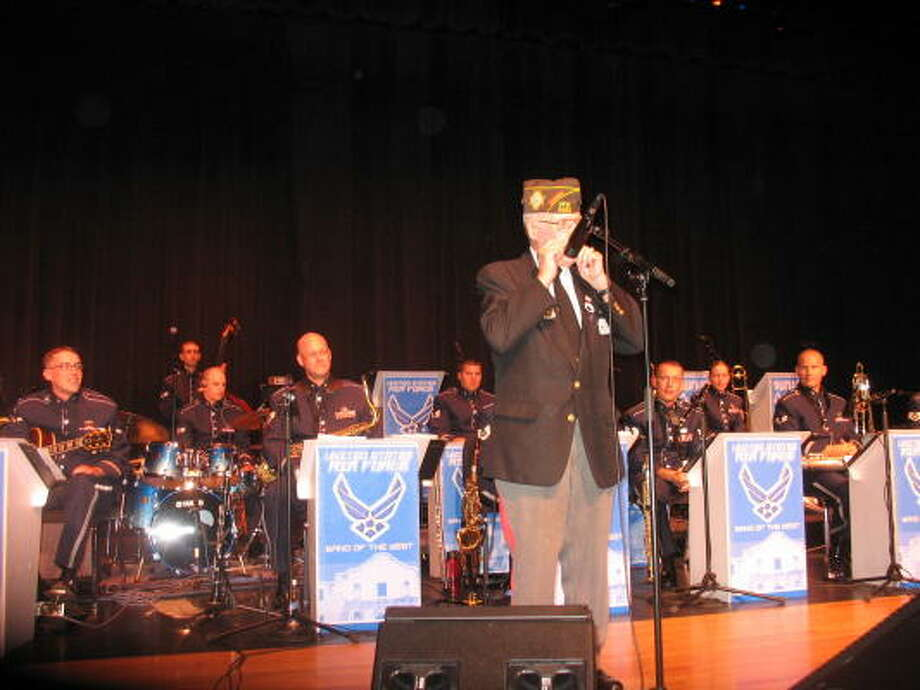 "World War II veteran George Berg played a harmonica solo during the USAF ""Dimensions in Blue"" jazz ensemble concert. Berg of Sugar Land belongs to Katy VFW Post 9182. Photo: COURTESY, KATY VFW POST 9182"