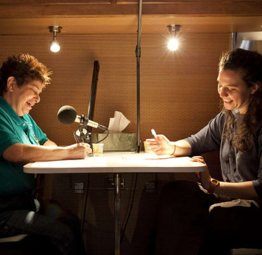 Candy Torres, left, goes over some notes before being interviewed by Whitney Henry-Lester for StoryCorps Historias, which documents the stories of Latinos in Houston and across the U.S. The recordings will be archived at the Library of Congress. Photo: Nathan Lindstrom, Chronicle