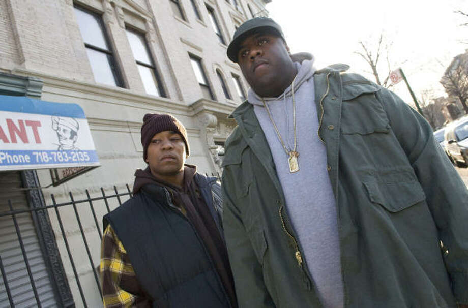 Dennis L.A. White, left, as Damion, lifelong friend of Christopher Wallace, played by Jamal Woolard in the film Notorious. Photo: Courtesy Photo