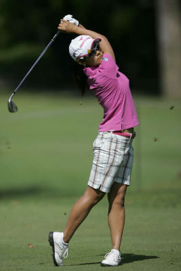Japan's Ai Miyazato, shown at the recent Lorena Ochoa Invitational, shows that plaid is still a great pattern for golfers. Photo: Miguel Tovar, AP