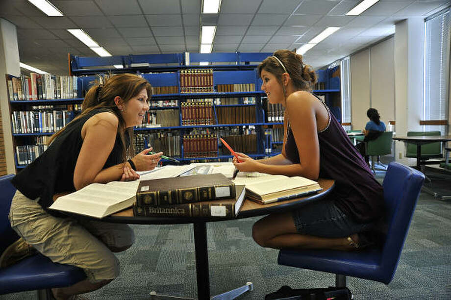 DOUBLE TEAM: Study time together has been a key to academic success for Robyn Camp, left, and her daughter Jessica Camp Photo: Rob Vanya, For The Chronicle