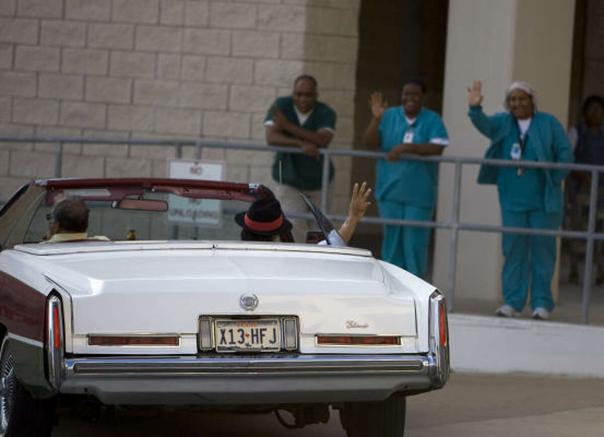 Pancho Claus, aka Richard Reyes, waves to Memorial Hermann Northwest Hospital employees as friend Hector Garcia drives him away in Reyes' signature Cadillac.