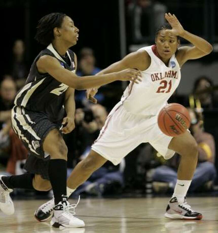 Amanda Thompson, right, gave Oklahoma a lift down the stretch against Purdue in the Elite Eight. Photo: Donna McWilliam, AP