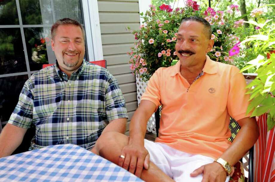 Joseph Eppink, left, and Ralph Panelli talk about their wedding plans on Tuesday, July 19, 2011, at their home in East Greenbush, N.Y. They'll get married on Sept. 17. (Cindy Schultz / Times Union) Photo: Cindy Schultz