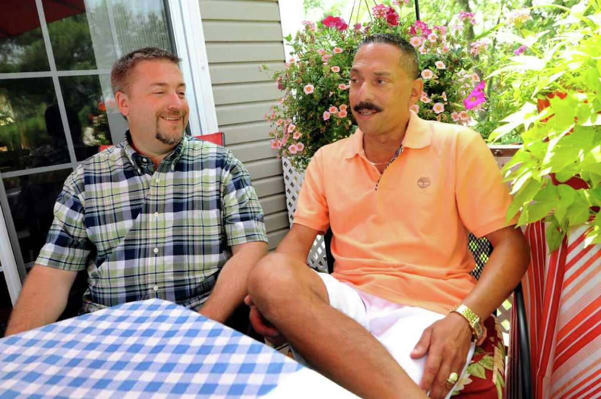 Joseph Eppink, left, and Ralph Panelli talk about their wedding plans on Tuesday, July 19, 2011, at their home in East Greenbush, N.Y. They'll get married on Sept. 17. (Cindy Schultz / Times Union)