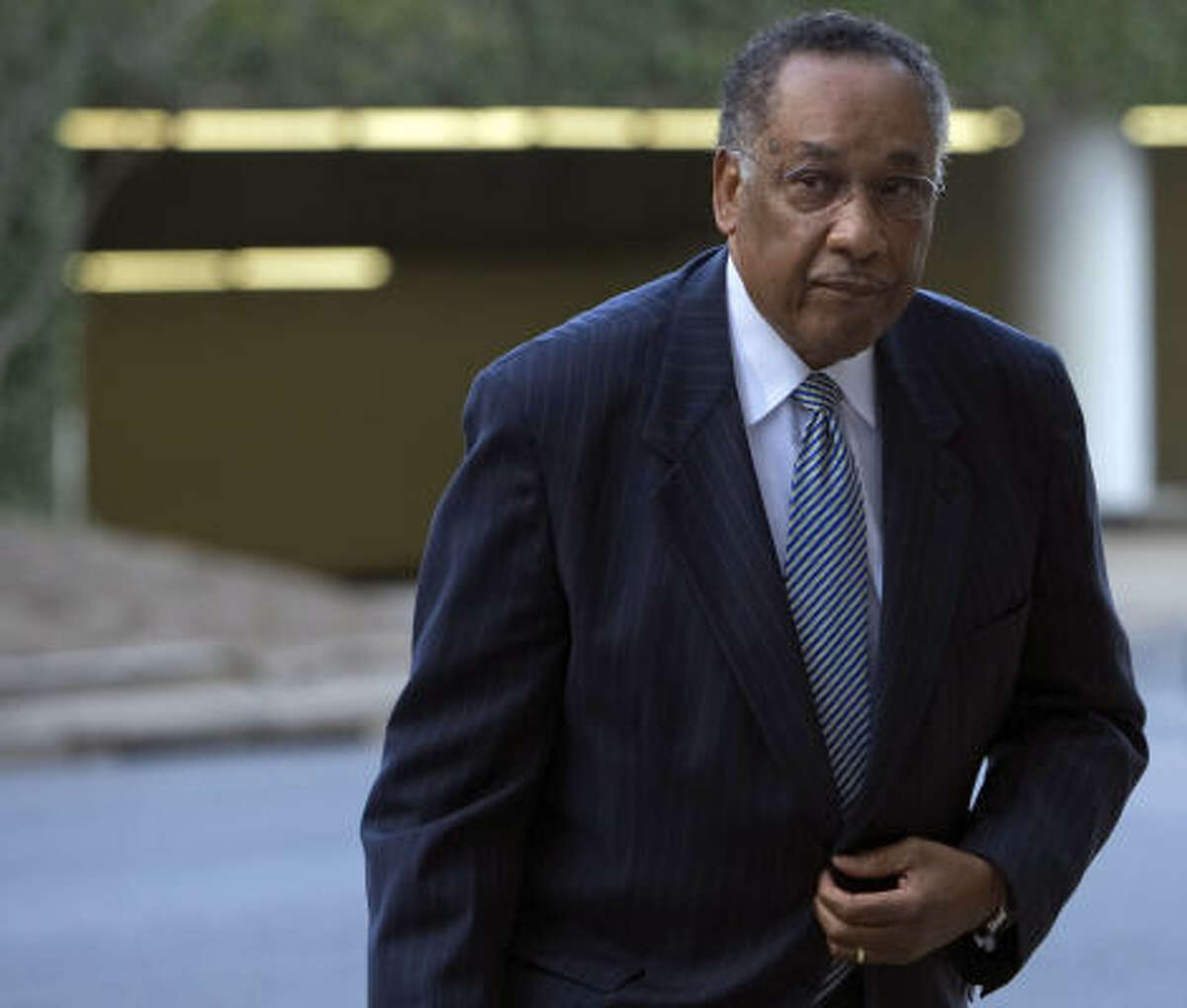 Former Houston Police Chief Lee P. Brown, arriving at the federal courthouse on Wednesday, said he was unaware of shoddy lab work and falsification of evidence until 2002.