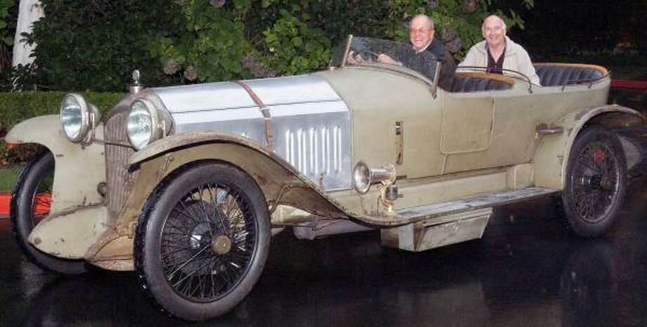 Charles Morse, left, in his 1919 Turcat-Mery. He paid $927,518 for it at a Paris event. Photo: BOB GASSEN, AP/HUMANATURE PHOTOGRAPHY