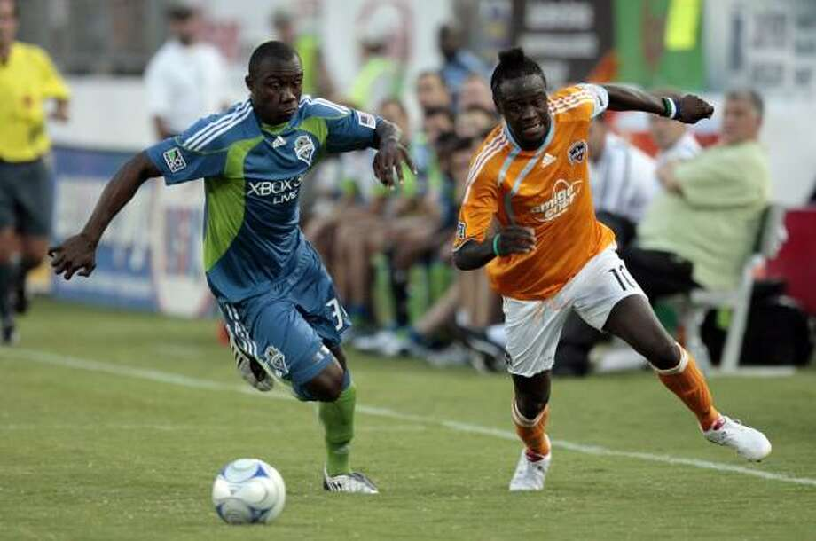 Dynamo striker Kei Kamara, right, was traded primarily for financial reasons, coach Dominic Kinnear said. Photo: Bob Levey, AP
