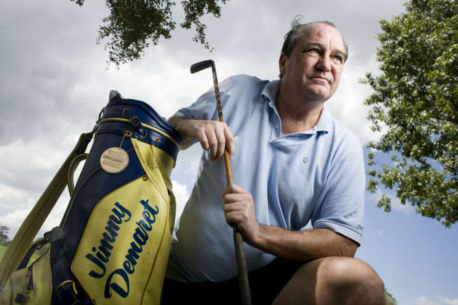 Ken Watkins has kept a golf bag and putter used by his uncle, three-time Masters champion Jimmy Demaret. Photo: Eric Kayne, For The Chronicle
