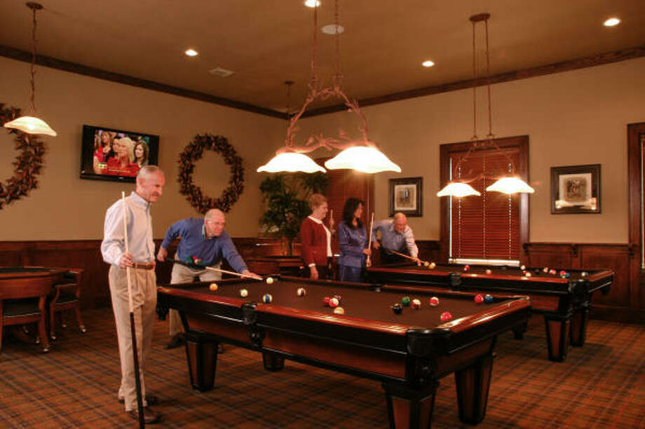 READY FOR RECREATION: The Heritage's 13,000-square-foot Lodge clubhouse and recreation center serves as a focal point for resident life and activities.