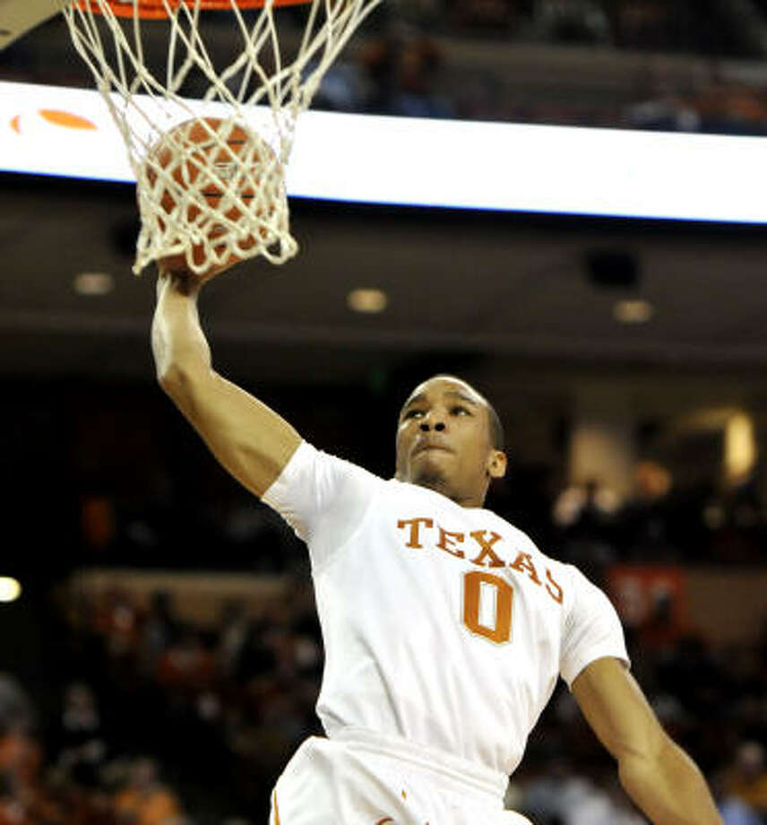 The Longhorns' Avery Bradley goes up for a dunk against Long Beach State in the second half. Photo: Michael Thomas, AP