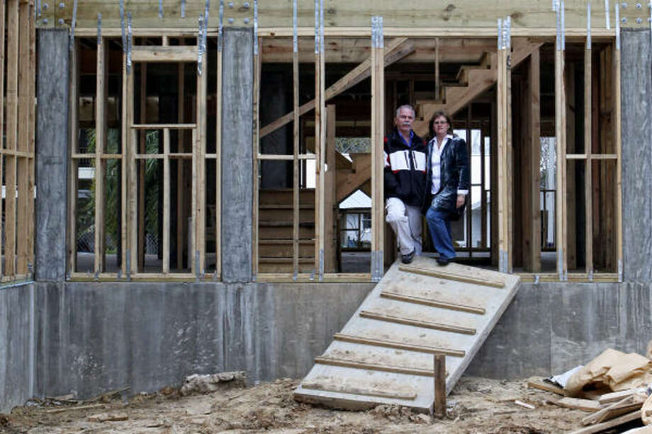 As Scott and Alison Putman battle their flood insurer over the amount of their claim, they're using their own money to rebuild the Kemah house they lost to Hurricane Ike. Photo: Todd Spoth, Chronicle