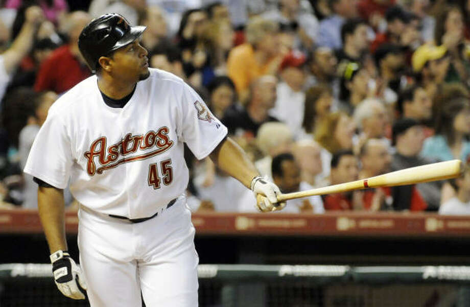 Astros left fielder Carlos Lee watches the ball go over the wall for a two-run homer in the fourth inning. Photo: Pat Sullivan, AP