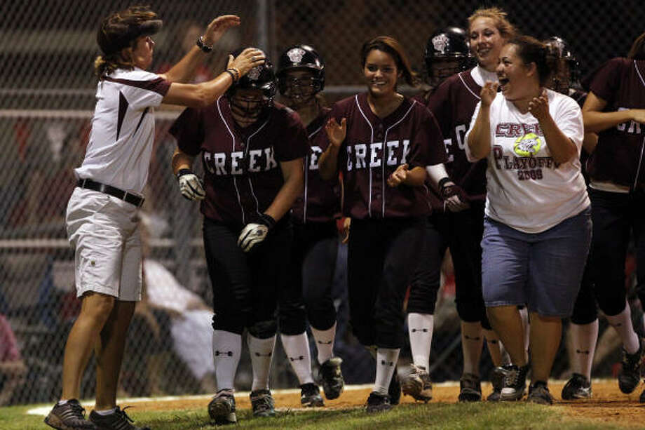 In three games against Katy, Clear Creek junior Misty Munley (center) had two home runs and two doubles. Photo: Todd Spoth, For The Chronicle