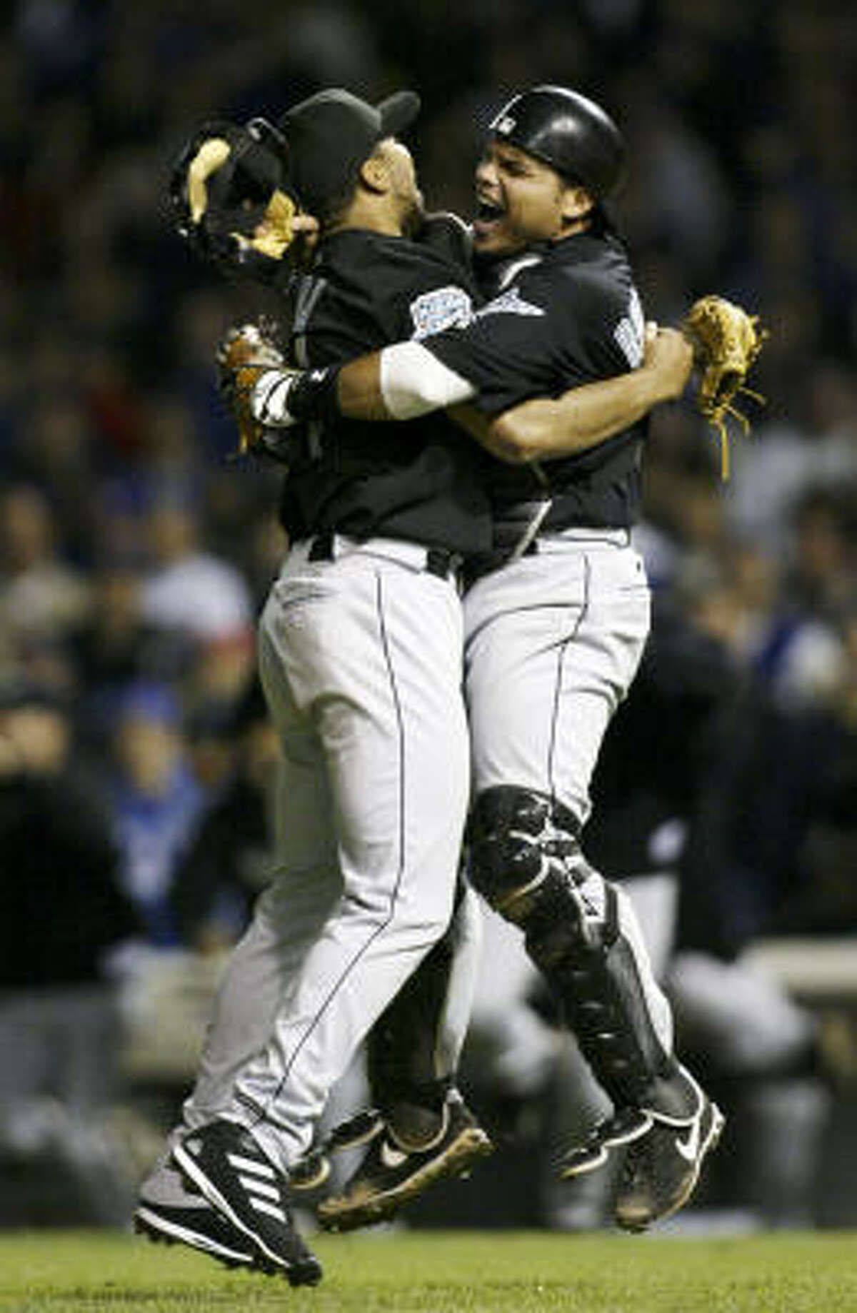 2003: Rodriguez and Marlins reliever Ugeth Urbina, left, enjoy the Marlins' NLCS victory that preceded their unlikely World Series win over the Yankees