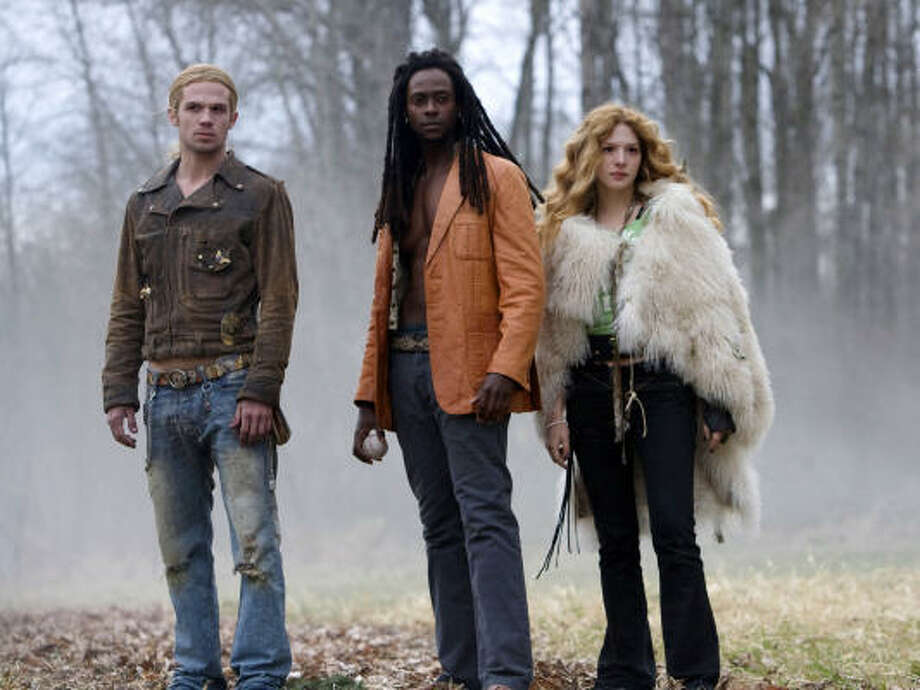 "In this image released by Summit Entertainment, Cam Gigandet, left, Edi Gathegi and Rachelle Lefevre, right, are shown in a scene from, ""Twilight."" Photo:  Peter Sorel, AP"