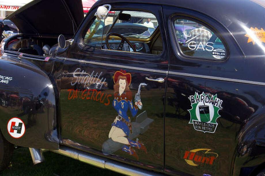 "Joe Hickenbottom's ""Slightly Dangerous"" 1940 Dodge gasser wears a vintage pinup on its side, and ""HEMI 325"" and a bold chrome ram's head ornament on the hood."
