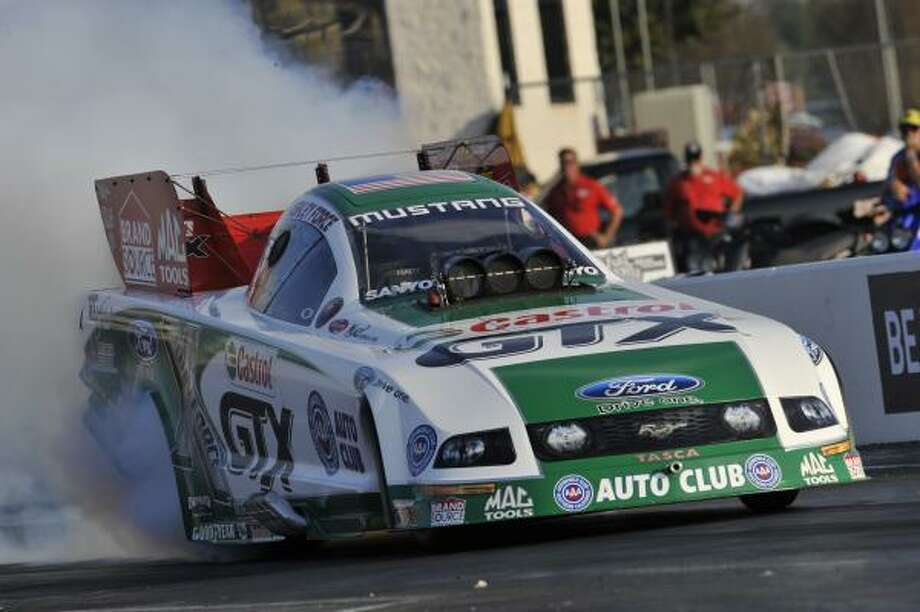 Funny Car racer Ashley Force Hood could give John Force Racing its first Funny Car championship since 2006. Photo: Jerry Foss, AP