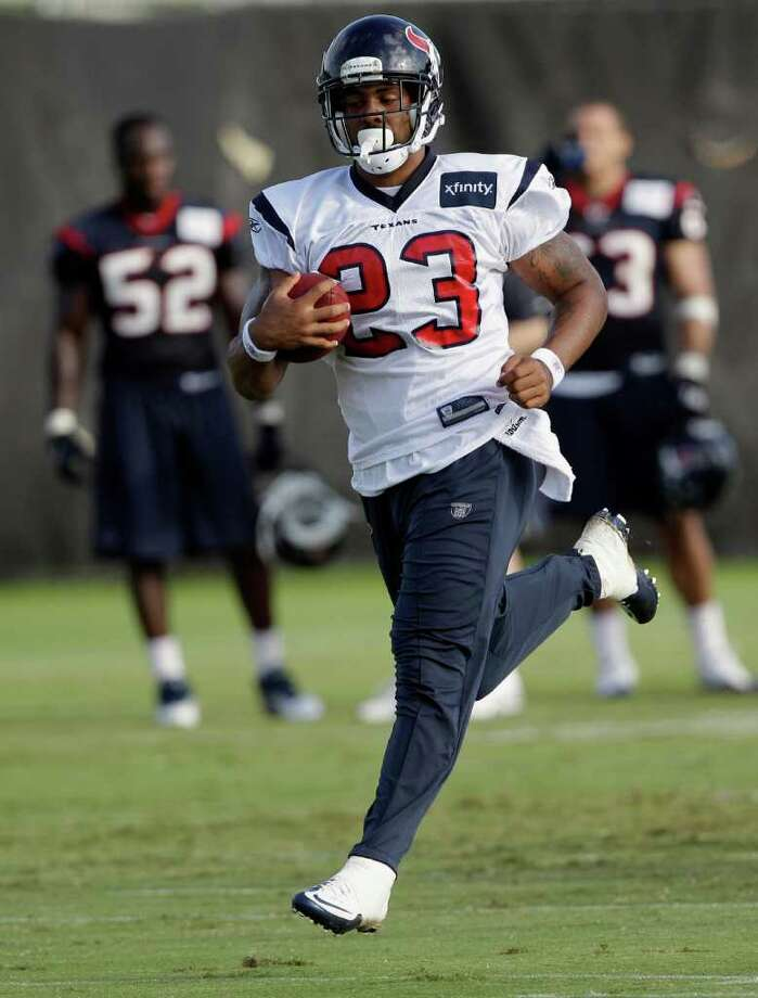 Texans running back Arian Foster jogs during Friday's training camp practice before he injured a hamstring. Photo: David J. Phillip/Associated Press