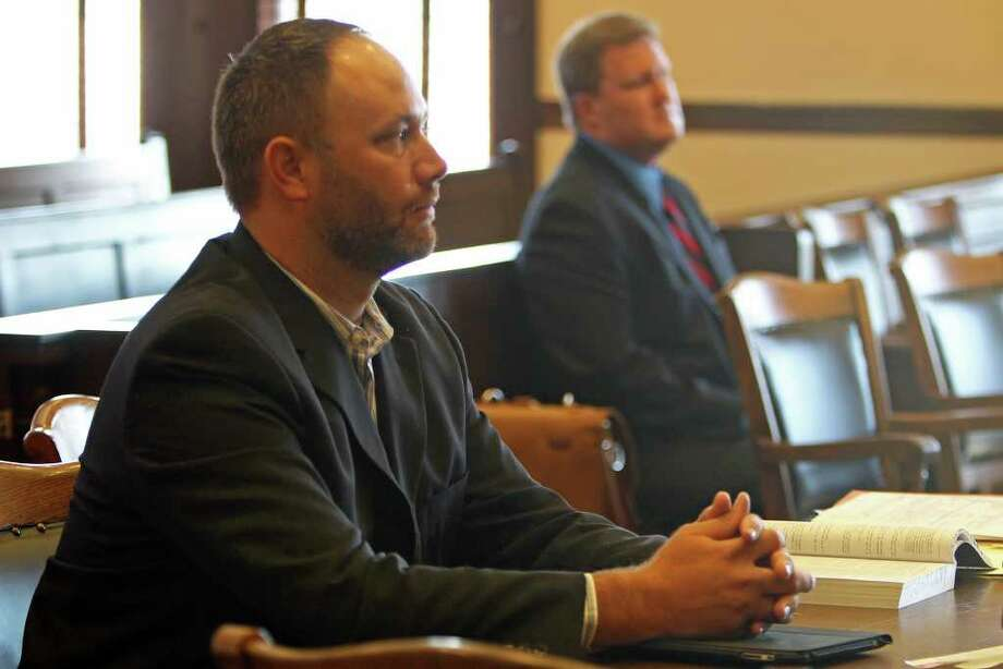 "Steven Newman, general manager of The Friendly Spot, watches as the lawyers speak to the judge after he lost his case during a hearing to determine whether The Friendly Spot can ""obtain documents and compel the testimony"" of its accused neighbors. (The ice house is trying to get its hands on a mysterious email that allegedly seeks to recruit people to videotape children at the business.), Friday, August 5, 2011. (Jennifer Whitney/ Special to the San Antonio Express-News) Photo: Jennifer Whitney, Jennifer Whitney/Special To The San Antonio Express-News / special to the Express-News"