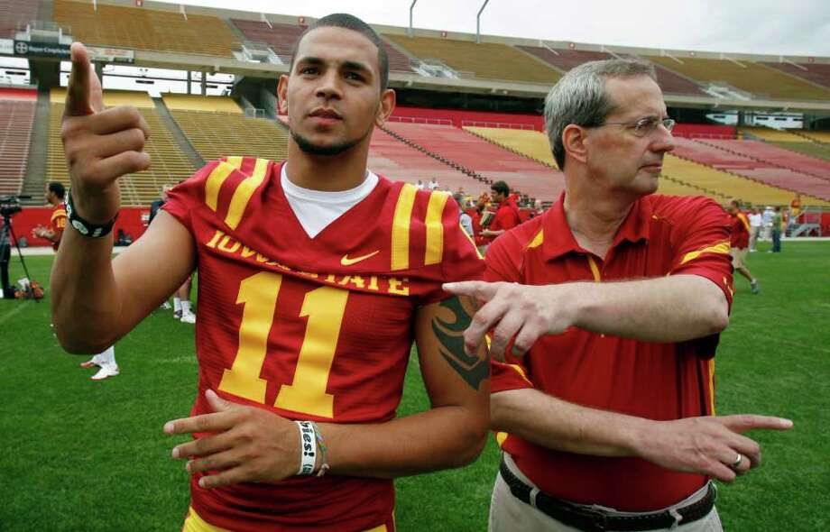 Iowa State quarterback Jerome Tiller, a Lee High School product, takes directions from ISU staff member Tom Kroeschell. Photo: Charlie Neibergall/Associated Press