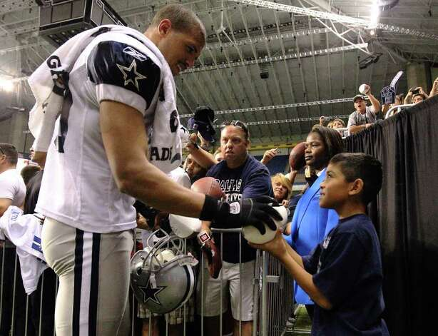 Tony Casas, 8, takes back a football autographed by Cowboys receiver Miles Austin after the evening session of the Dallas Cowboys training camp at the Alamodome on Thursday, Aug. 4, 2011. Photo: Kin Man Hui/kmhui@express-news.net / SAN ANTONIO EXPRESS-NEWS