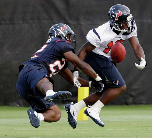 Houston Texans cornerback Sherrick McManis, left, breaks up a pass intended for wide receiver Trindon Holliday, right, during NFL football training camp, Tuesday, Aug. 2, 2011, in Houston. (AP Photo/David J. Phillip) Photo: David J. Phillip/Associated Press