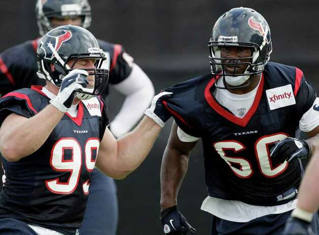 Houston Texans defensive end John Graves (60) and J.J. Watt (99) during an NFL football training camp practice Tuesday, Aug. 2, 2011, in Houston. (AP Photo/David J. Phillip) Photo: David J. Phillip/Associated Press