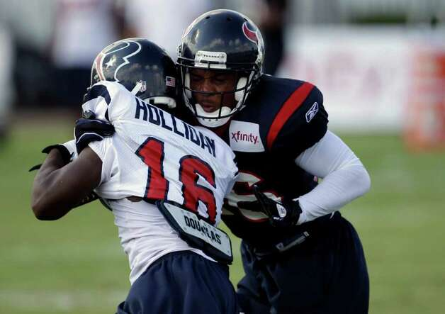 Houston Texans cornerback Roc Carmichael (36) and wide receiver Trindon Holliday (16) during an NFL football training camp practice Wednesday, Aug. 3, 2011, in Houston. (AP Photo/David J. Phillip) Photo: David J. Phillip/Associated Press