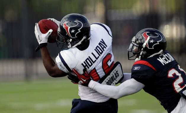 Houston Texans wide receiver Trindon Holliday (16) and cornerback Sherrick McManis (22) during an NFL football training camp practice Wednesday, Aug. 3, 2011, in Houston. (AP Photo/David J. Phillip) Photo: David J. Phillip/Associated Press