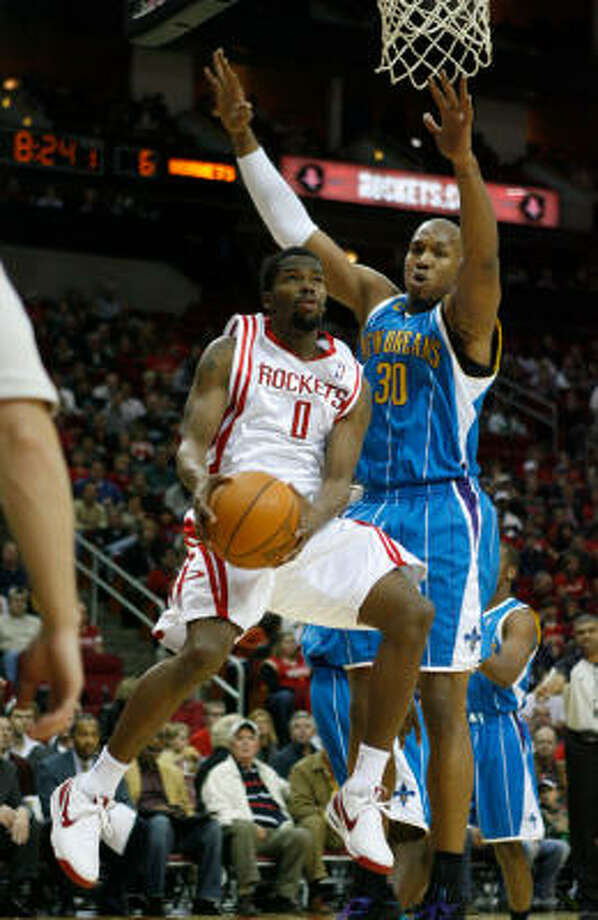 Dec. 29: Rockets 108, Hornets 100Rockets guard Aaron Brooks goes up for a layup against Hornets forward David West in the first quarter. Photo: Julio Cortez, Chronicle
