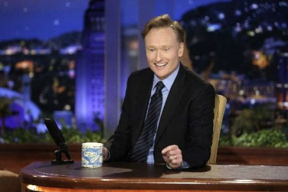 June 1: Opening with a kicky skit featuring Conan sprinting across America from New York City to his new home in Los Angeles, The Tonight Show with Conan O'Brien debuts with Will Ferrell and Pearl Jam as its first guests. Photo: NBC