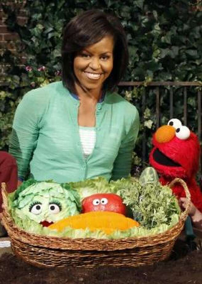 Nov. 10: Michelle Obama appears on Sesame Street, commemorating the series' 40th anniversary. Photo: Associated Press