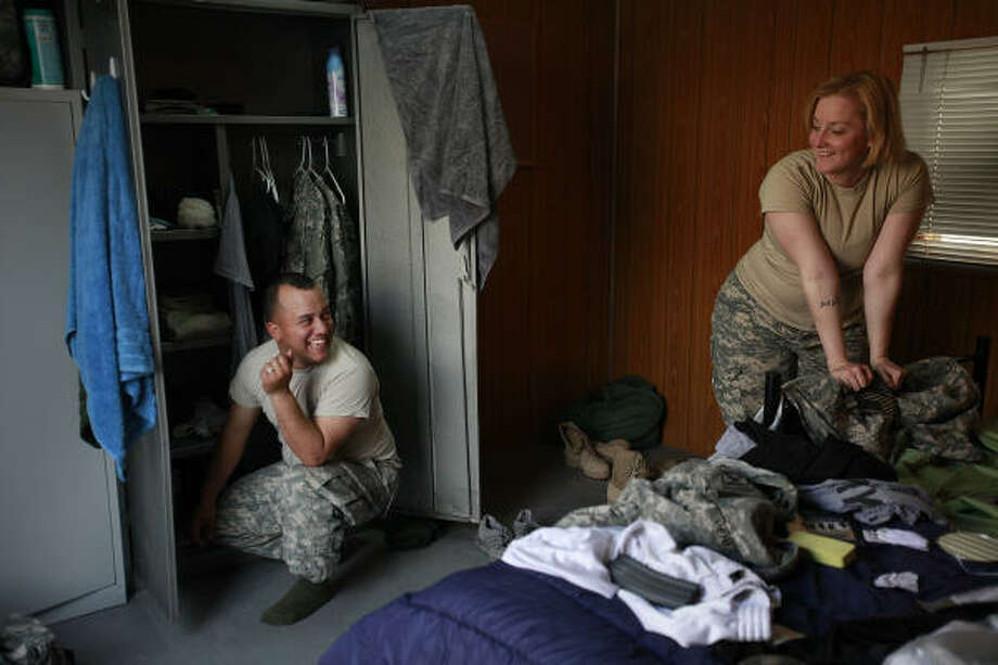 Houstonian Sgt. Miguel Perez, 24, and Spc. Amanda Perez, 23, move into their CHU (Containerized Housing Unit) on Dec. 24, 2009. The 130-square-foot CHU at Camp Prosperity in Baghdad is technically their first apartment as a married couple. Sgt. Perez and Spc. Perez got married in October during leave from pre-mobilization training, and deployed together with the Texas National Guard's 72nd Infantry Brigade Combat Team. Photo: Mayra Beltran, Chronicle