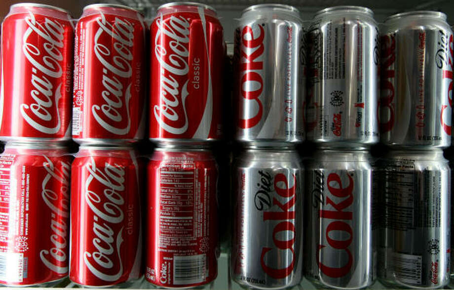 U.S.: Soda. Some imbibers swear by ice-cold classic Coca-Cola. It's caffeinated and the carbonation scrubs that awful taste out of your mouth. Photo: Justin Sullivan, Getty Images