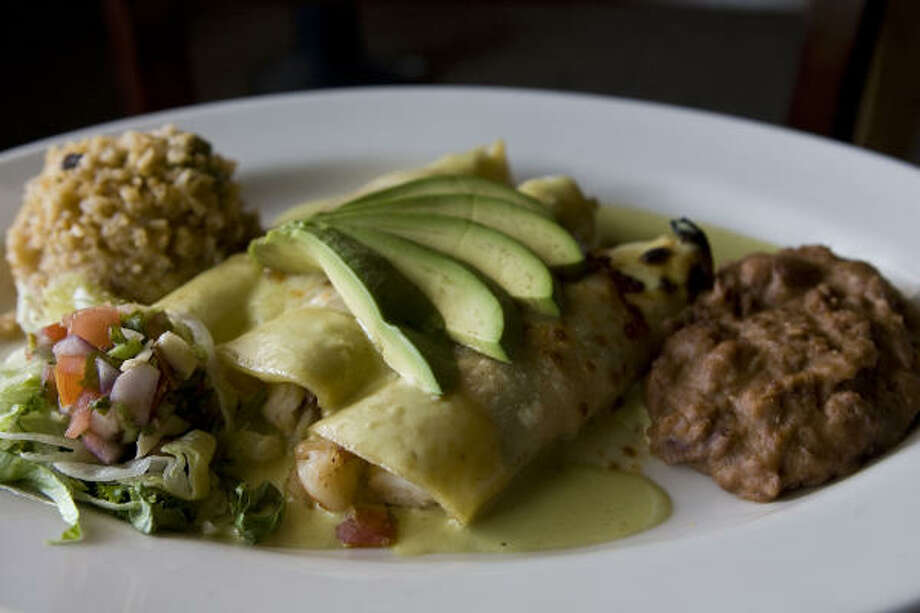 Some folks swear by greasy enchiladas the day after a night of drinking. Photo: James Nielsen, Houston Chronicle