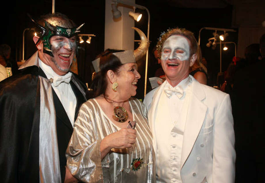 """When the dress code calls for costumes, Houstonians are not the least, uh, closeted. Everyone was in the spirit for the Orange Show Gala, """"Angels and Demons on the Bayou."""" Although if you can remember it, you probably weren't there. From left are Victor Juarez, Marilyn Oshman and Wayne Blosat. Photo: Gary Fountain, For The Chronicle"""