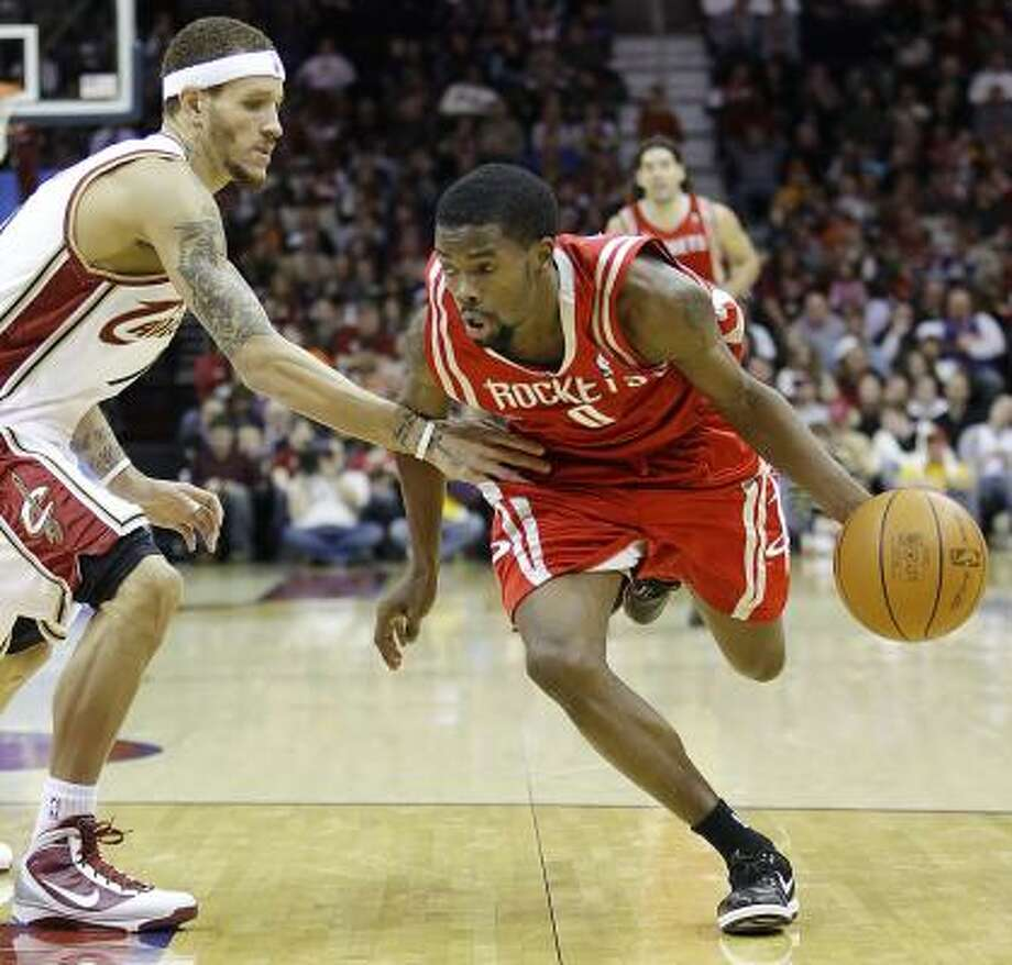 Rockets guard Aaron Brooks, right, scored a team-high 23 points in Sunday's game against the Cleveland Cavaliers, but it wasn't enough to prevent Houston from losing 108-83. Photo: Ron Schwane, AP