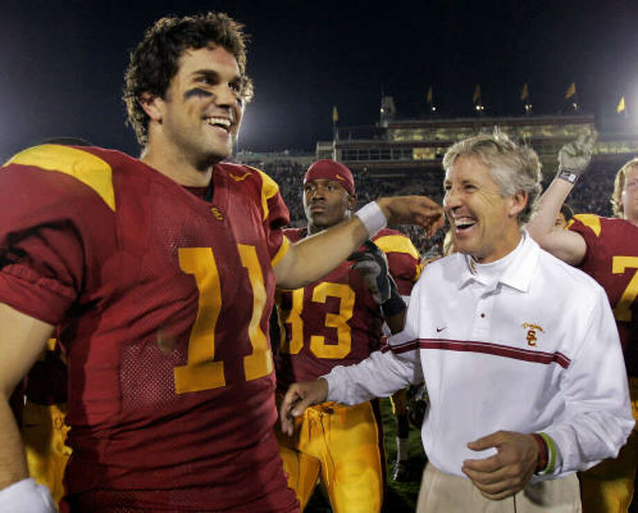 USC  Head coaches: Paul Hackett (2000), Pete Carroll (2001-present).   Record: 101-26.   Against ranked teams: 37-11.   Conference titles: 7 (includes 3 co-championships).    Bowls: 6-2.   BCS bowls: 6-1.  Top 25 finishes: 7.      Top 10 finishes: 7.     Top 5 finishes: 7.  Highlights: 2003 AP national champion, BCS national champion in 2004 (55-19 over Oklahoma).    Disappointments: 2008 team was 5-7, last in Pac-10. Photo: KEVORK DJANSEZIAN, AP