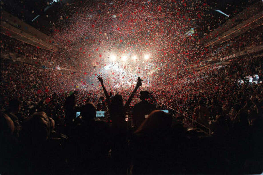 Dec. 31, 1999  |  A downpour of confetti showers the fans who chose to bring in the new century with classic rockers ZZ Top at the Compaq Center. Photo: James Nielsen, SPECIAL TO THE CHRONICLE