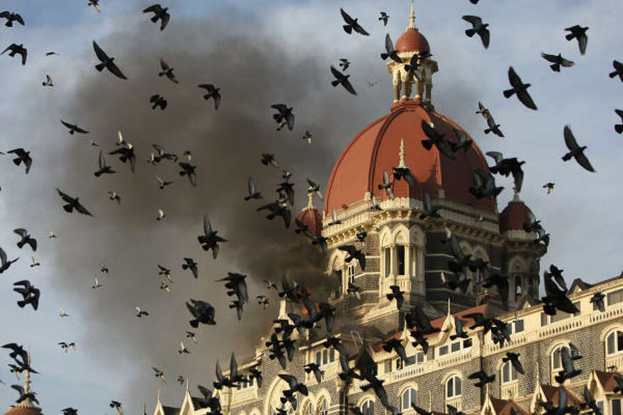 Nov. 27, 2008  |  Flames gush out of The Taj Mahal Hotel in Mumbai on November 27, 2008, one