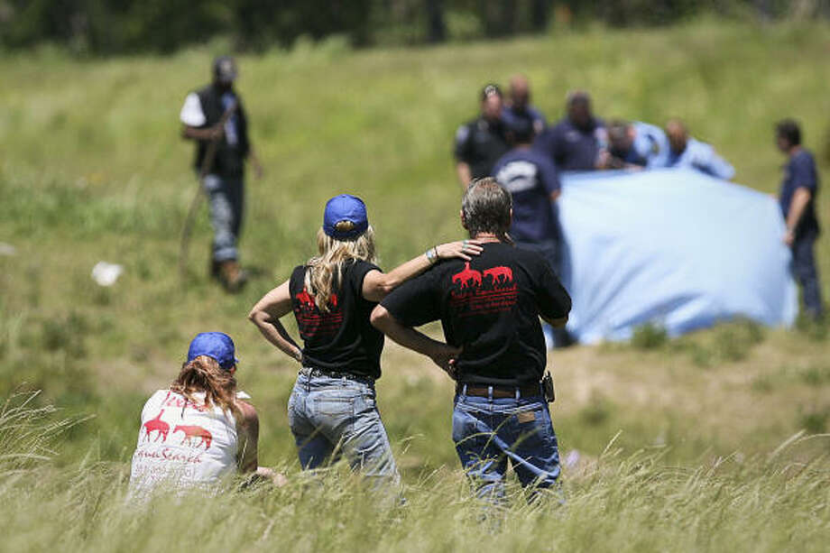 April 21  | Texas EquuSearch members view the scene where a missing four year-old was found along the banks of the ditch where it forks into Greens Bayou near Beltway 8 and Aldine-Westfield Rd.  The location is about a mile away from the location of the accident where five children lost their lives when their father drove the car into a ditch filled with rain water. Photo: Mayra Beltran, Houston Chronicle