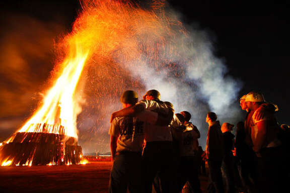 Nov. 24   | Members of Walton Hall watch the off-campus Aggie Bonfire in Bryan, TX. Walton Hall is responsible for loading the lumber that is cut and following the tradition of bringing the flame from Austin to light the fire.