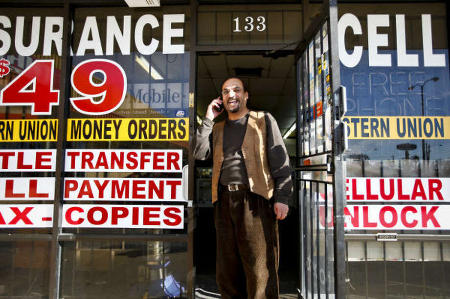 Mike Nasr kept his business, Cell Com Wireless on Little York, opened to accommodate last-minute shoppers. Read more about other holiday workers here. Photo: Michael Paulsen, Chronicle