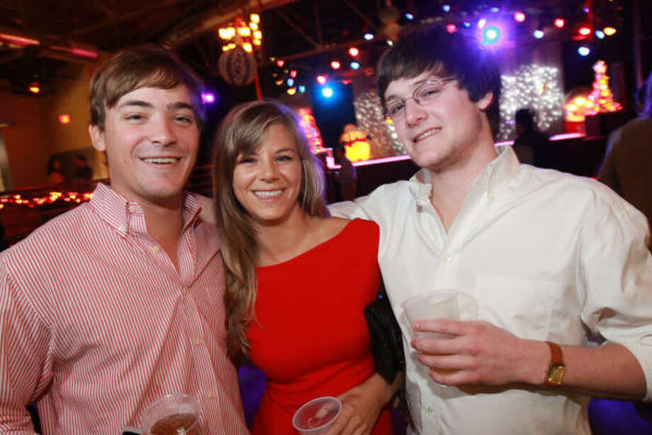 James Brooks, Ellen Woolen and J. Hover at the fourth annual Eve Before Christmas Eve Party at Warehouse Live. Photo: Bill Olive, For The Chronicle