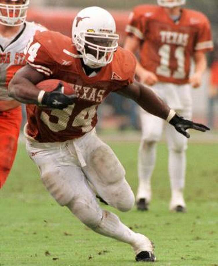 1995-98:Ricky Williams starred at the University of Texas, rushing for 6,279 yards in four years to become the NCAA's Division I-A career rushing leader. Photo: TIM SHARP, AP