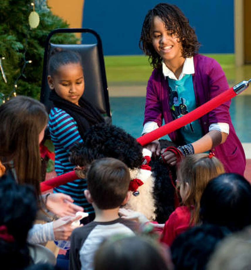Bo, the first dog, visited Children's National Medical Center in Washington, D.C. with Sasha Obama, left, and Malia Obama, daughters of President Barack Obama, Photo: SAUL LOEB, AFP/Getty Images