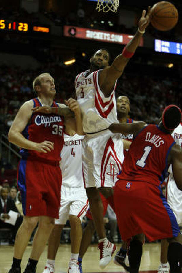 Dec. 22: Rockets 108, Clippers 99Rockets forward Tracy McGrady attempts to grab an offensive rebound next to the Clippers' Chris Kaman (35) and Baron Davis (1) during the first half. Photo: Johnny Hanson, Chronicle