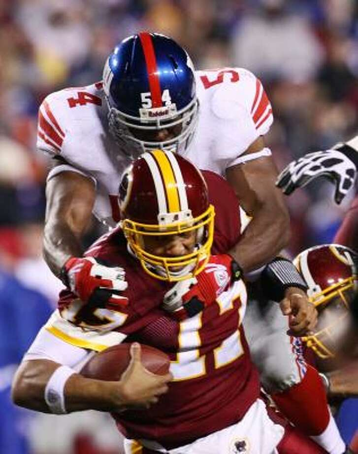Dec. 21: Giants 45, Redskins 12 Redskins quarterback Jason Campbell was sacked five times and intercepted twice by the Giants' defense. Photo: Win McNamee, Getty Images